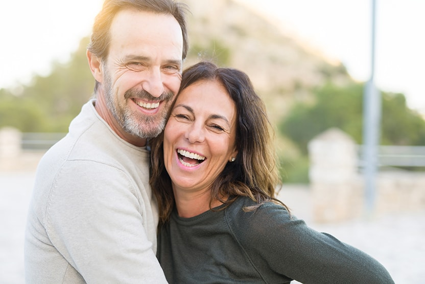 Adult couple smiling